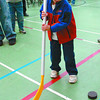 aimhi fun fair 1 in monday dave milne oct 15 05 Three-year-old Kyle Smith takes a swing at a puck with a stick bigger than he is at the AimHi Fun Fair Saturday at the AimHi gymnsium. The event was put on jointly by the West Bowl Community Association and AimHi to raise money for young climbers going to Mount Kilimanjaro and the Quinson Elementaryry School Choir trip to Ottawa.