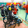 aimhi fun fair 2 in monday dave milne oct 15 05 Nine-year-old Jack Giguere tries his hand at getting through a door in a wheel chair, closing the door on the others side, opening the door and coming back through. This game made participants like Jack aware of some of the difficulties confronting people with disabilities. Most games were just for fun at the AimHi Fun Fair Saturday at the AimHi gymnsium. The event was put on jointly by the West Bowl Community Association and AimHi to raise money for young climbers going to Mount Kilimanjaro and the Quinson Elementaryry School Choir trip to Ottawa.