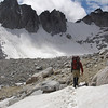 Jim trudging through a snow field in the Upper Enchantments Basin