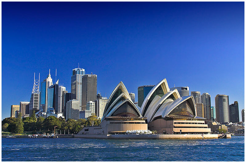 Sydney Harbour, Monday August 8th 2005. <br /> <br /> A simple postcard style view of the Opera House from the harbour. <br /> <br /> EXIF DATA <br /> Canon 1D Mk II. EF 17-35 f/2.8L USM @35mm. 1/100s f/9. Shutter Priority. ISO 400.