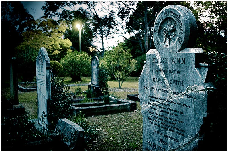 Lane Cove North, Thursday, August 25th 2005. <br /> <br /> This old churchyard cemetery has previously suffered from vandals with many tombstones having been repaired. <br /> <br /> EXIF DATA <br /> Canon 1D Mk II. EF 17-35mm @17mm f/2.8 1/30s f/2.8. Shutter Priority. ISO 800.