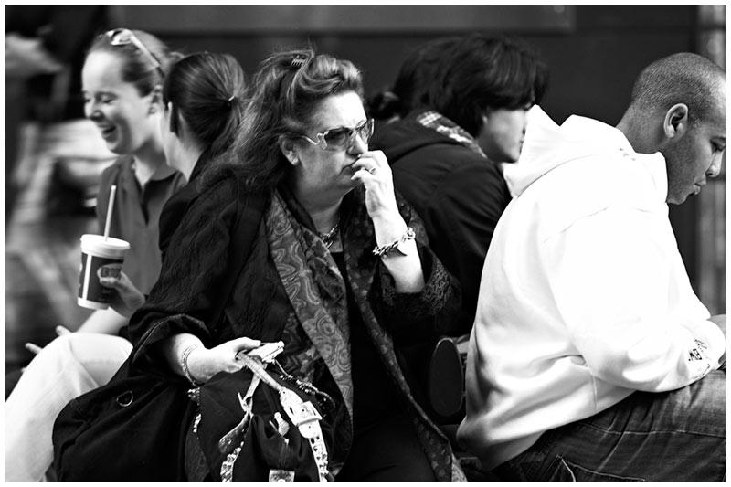 Pitt Street, Monday, August 22nd 2005. <br /> <br /> Pensive.  <br /> <br /> EXIF DATA <br /> Canon 1D Mk II. EF 70-200mm @200mm f/2.8. 1/40s f/4 Aperture Priority. ISO 200.