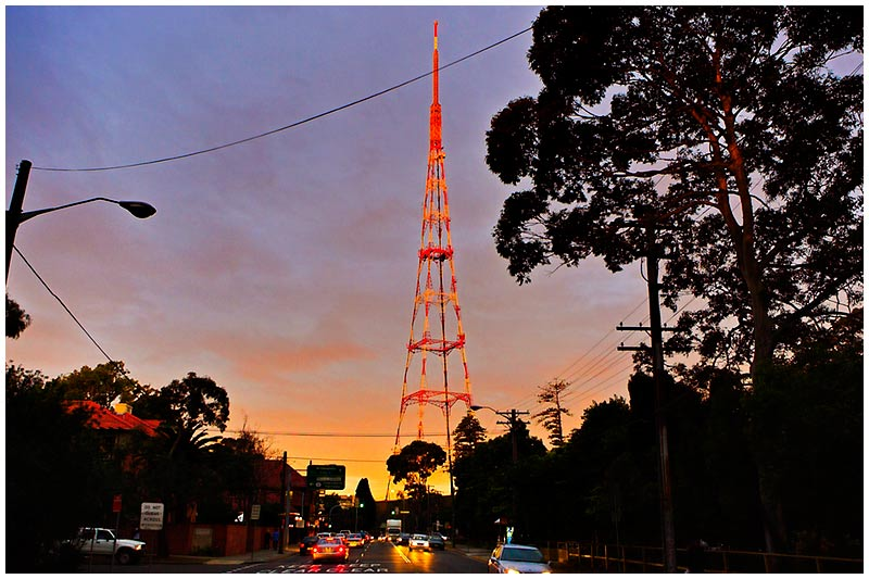 Mowbray Rd, Chatswood, Wednesday August 31st 2005. <br /> <br /> The setting sun threw off this amazing rich golden light that just lit up the television station antenna. <br /> <br /> EXIF DATA <br /> Canon 1D Mk II. EF 17-35 f/2.8L@17mm 1/80s f/3.5 Shutter Priority ISO 400.