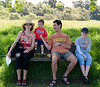 Aunt Caroline, Cousin Joey, Uncle Chip, and Isabel relax on a bench in the Arastradero Reserve.