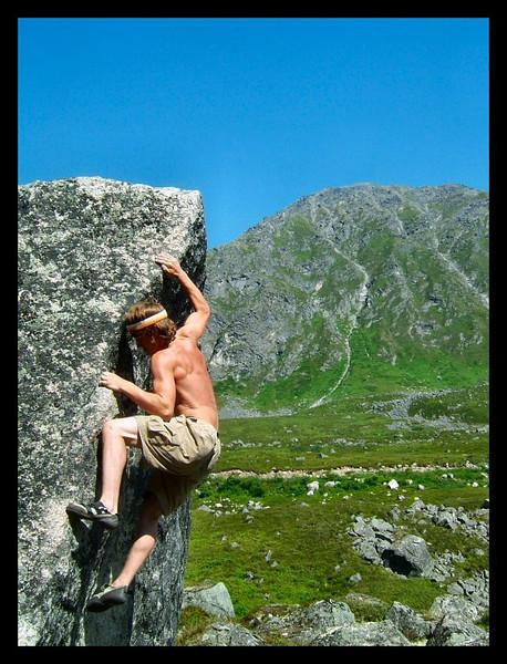 Ryan Pallister works a V3 under the hot sun in Archangel Valley.