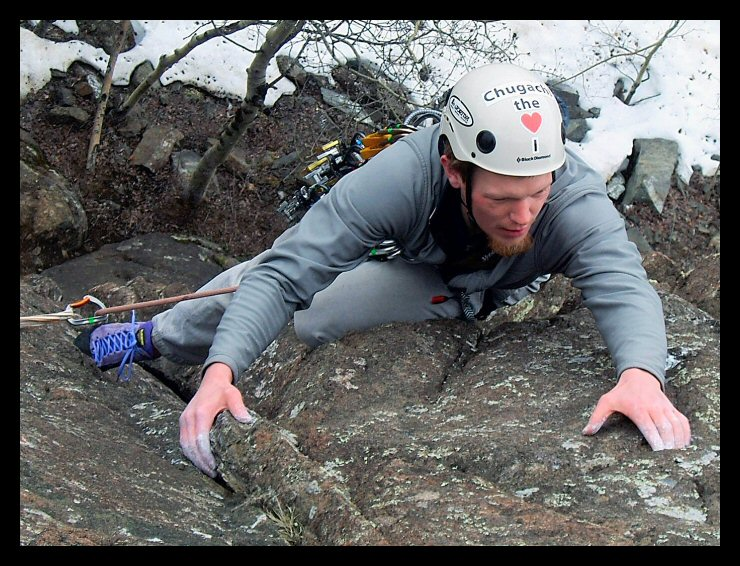 The common Alaskan bumper sticker takes on a new form on Chad Gailey's climbing helmet, climbing <i>Cake Walk 5.8</i> at Purinton Creek.
