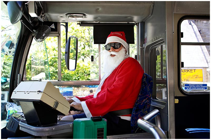 Darling St, Balmain, Sunday December 18th 2005. <br /> <br /> With a week to go to Christmas this bus driver is certainly in the festive spirit.  <br /> <br /> EXIF DATA <br /> Canon 1D Mk II. EF 17-35 f/2.8L@35mm 1/125s f/4.5 ISO 200.