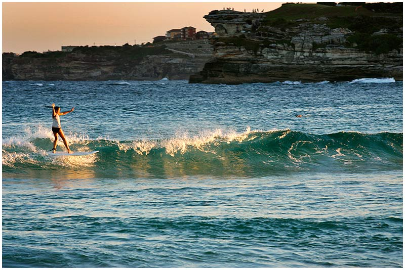 Bondi Beach, Thursday December 22nd 2005. <br /> <br /> This young surfer enjoys the last of the daylight as the sun sets over Bondi. <br /> <br /> EXIF DATA <br /> Canon 1D Mk II. EF 70-200 f/2.8L@200mm 1/200s f/9 ISO 400.