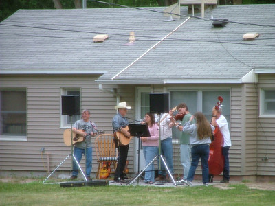 A bluegrass band practicing in back of the house behind my house.