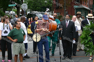 Pete Seeger performs during the street renaming ceremony