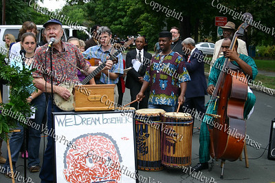 Pete Seeger performs during the street renaming ceremony. Kazi Oliver and Chris Sullivan join in.