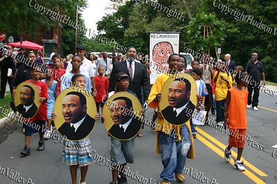 Children hold pictures of Dr. King as they  march to the King monument
