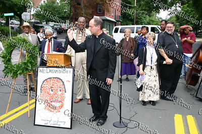 Fr Bill Scafidi blesses Dr. Martin Luther King Blvd