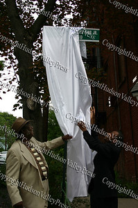 Rev McClearn and Damon Finch unveil sign for the Dr. Martin Luther King Blvd designation