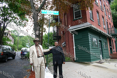 Rev McClearn and Damon Finch unveil sign at Colden St for the Dr. Martin Luther King Blvd designation