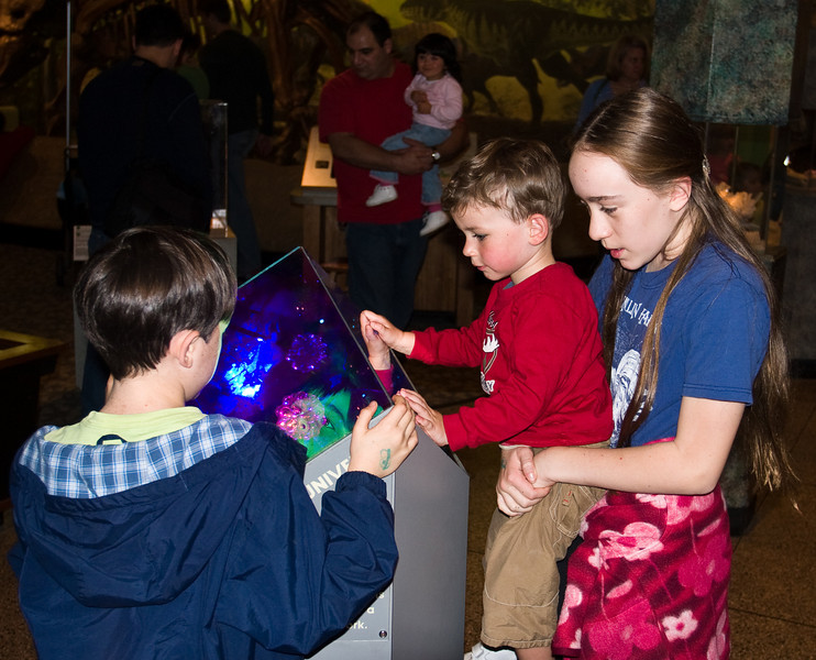 Benjamin and Isabel showing Joey the crystal exhibit