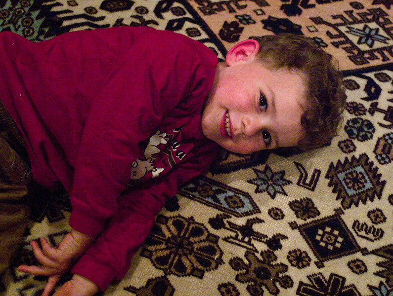 Cousin Joey lying on the living room rug