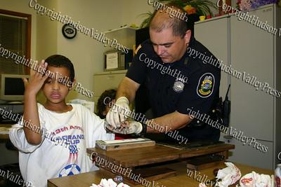 Danarias Smith is fingerprinted by Newburgh Police Officer John Generose