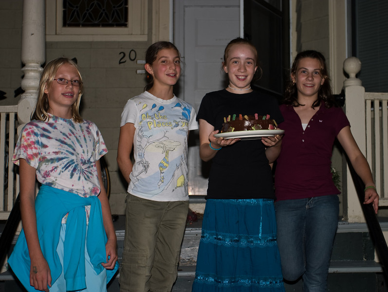 Isabel holding her cake, with friends Maxine, Isabelle, and Megan