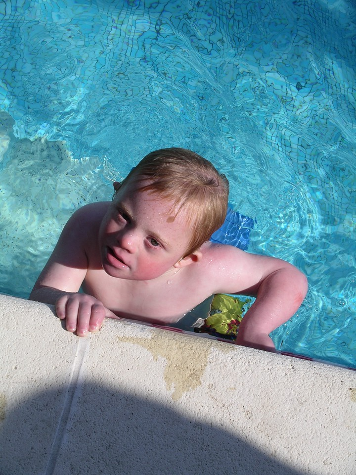 Sammy clings to the side of the pool