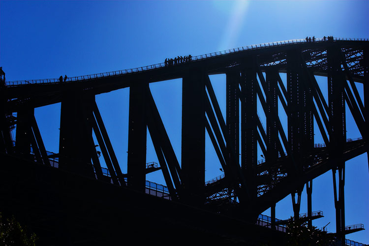 Sydney Harbour Bridge, Monday, 11.50 July 18th 2005. <br /> <br /> Climbing the Harbour bridge is a hugely popular activity for tourists and locals alike. Hundreds of people make the organised 3.5 hour climb every day.  <br /> <br /> EXIF DATA <br /> Canon 1D Mk II. EF 70-200 f/2.8L USM @70mm. 1/200s f/14. Shutter Priority. ISO 200.