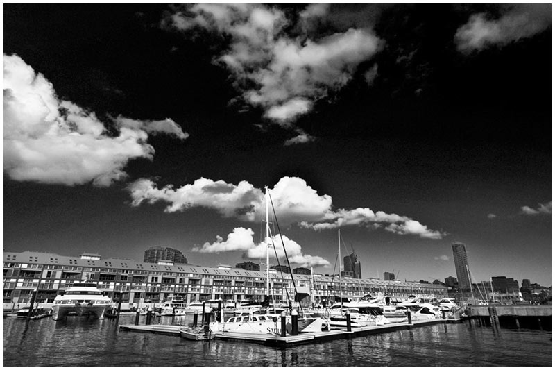 Woolloomooloo Bay Marina, Monday, July 25th 2005 . <br /> <br /> A beautiful warm day in Sydney with a few puffs of white cloud seems to be heralding the end of Winter. <br /> <br /> EXIF DATA <br /> Canon 1D Mk II. EF 17-35 f/2.8L USM @17mm. 1/80s f/14. Shutter Priority. ISO 200.