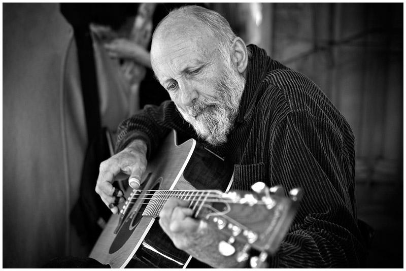 Balmain Markets, Balmain, Saturday,  July 23rd 2005. <br /> <br /> Acoustic guitarist Ray Scott makes an appearance at the Balmain Markets on Darling Street. <br /> <br /> EXIF DATA <br /> Canon 1D Mk II. EF 24-70 f/2.8L USM @50mm. 1/160s f/2.8. Aperture Priority. ISO 100.