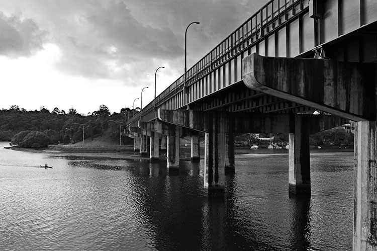 Fig Tree Bridge, Lane Cove River, Sunday 14.50 July 10th 2005. <br /> <br /> <br /> A cold and wintery day in Sydney. This canoeist must have been freezing with the Antarctic wind that was blowing across the city today. <br /> <br /> EXIF DATA <br /> Canon 1D Mk II. EF 17-35 f/2.8L USM @35mm. 1/80s f/8. Shutter Priority. ISO 200.