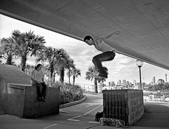 Anzac Bridge, Rozelle, Friday 12.20 June 3rd 2005<br /> <br /> Directly underneath the Anzac bridge were two guys practising jumps on their skateboards. (I'm sure there is some cool technical term for these jumps, but I forgot to ask) <br /> <br /> EXIF DATA<br /> Canon 1D Mk II. EF 17-35 f/2.8L USM @17mm. 1/50s f/4. Shutter priority. ISO 400.