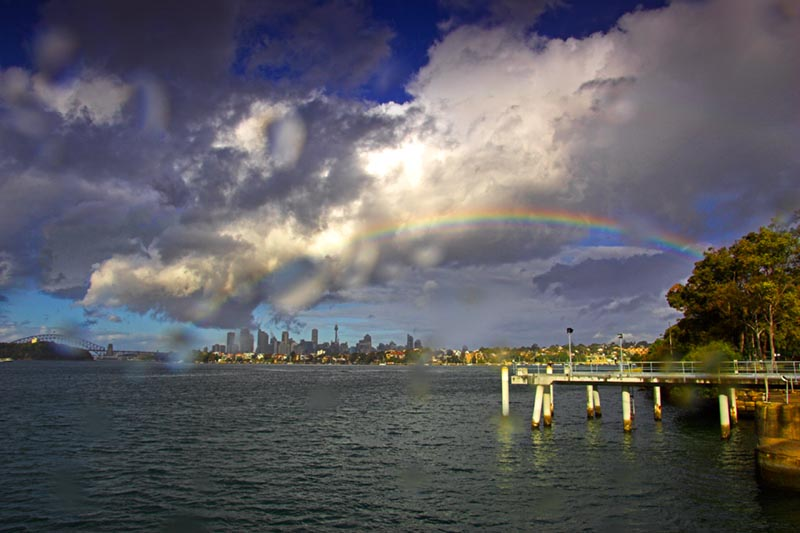 Clarkes Point, Woolwich, Saturday 14.05 June 25th 2005.<br /> <br /> A rainbow makes an appearance during a rain shower. I was unable to stop the raindrops getting on my lens. It's good to finally have some rain over the last few days in Sydney.<br /> <br /> EXIF DATA <br /> Canon 1D Mk II. EF 17-35 f/2.8L USM @17mm. 1/125s f/22. Shutter priority. ISO 200.