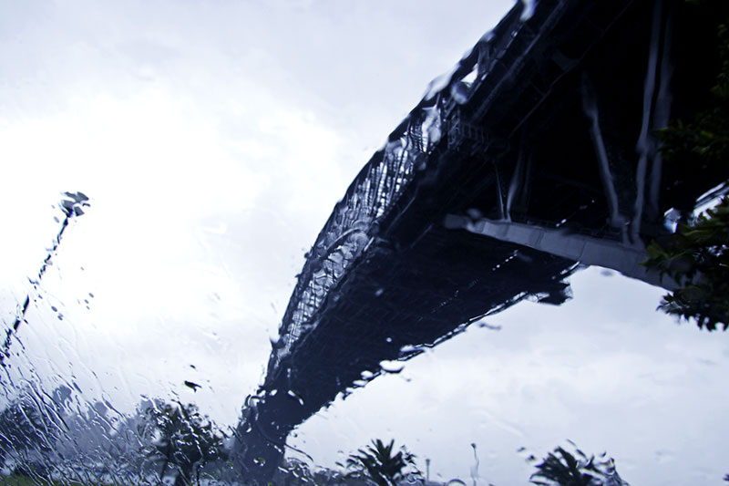 Sydney Harbour Bridge, Milsons Point, Thursday 14.05 June 30th 2005 . <br /> <br /> Sydney has had showery weather over the last few days and now heavy rain has begun to fall. But the much needed rain brings its own problems. Localised flooding in the city, road accidents and in the north of New South Wales, flood waters are expected to rise above 10m tonight in the city of Lismore and could flow over a levee protecting the central business district. About 3000 people are being evacuated. <br /> <br /> EXIF DATA <br /> Canon 1D Mk II. EF 17-35 f/2.8L USM @17mm. 1/250s f/5.6. Shutter priority. ISO 400.