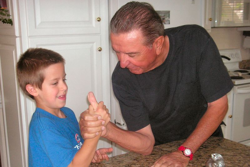 Jacob and Poppa thumbwrestling (Jacob still owes him $20 on that bet!)