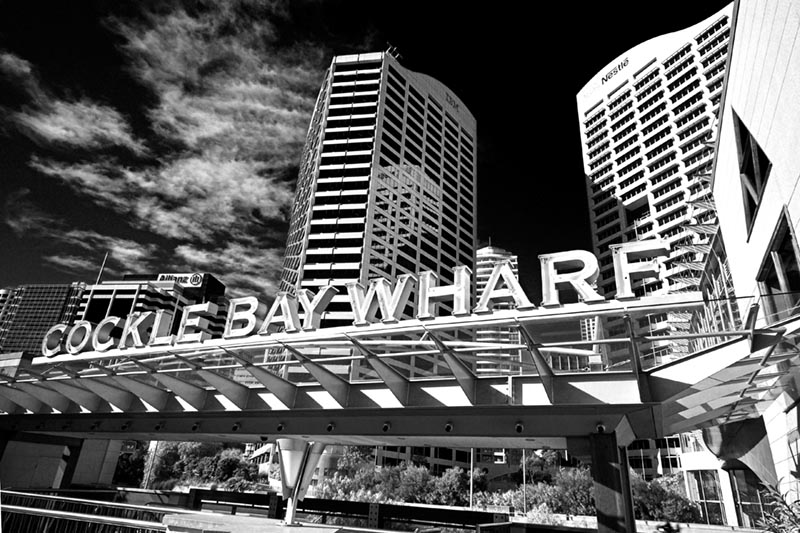 Cockle Bay Wharf, Darling Harbour, Wednesday 11.05 June 22nd 2005.<br /> <br /> Cockle Bay Wharf, on Darling Harbour, was Sydney's first purpose built dining and entertainment precinct. It was completed in the late 1990's. This view towards the city takes in the towering office blocks of Darling Park. The weather was bright and sunny, but rather cold. It really feels as though winter has finally arrived. <br /> <br /> EXIF DATA <br /> Canon 1D Mk II. EF 17-35/2.8L USM @17mm. 1/60s f/13. Shutter Priority. ISO 200.