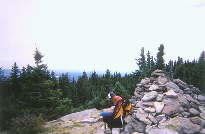 Reading the summit register on Mount Baldy, 11420'.