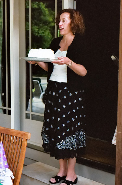 Caroline brings out the birthday cake.