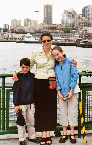 Benjamin and Isabel with Aunt Marian on the ferry, with the Seattle skyline behind.
