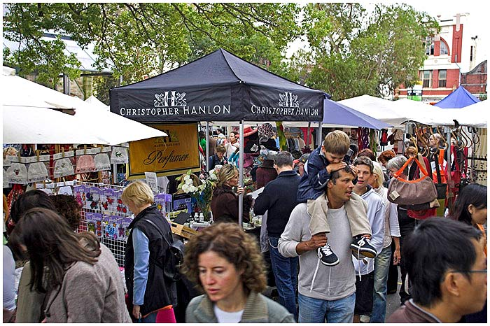 May 7th 2005.<br /> <br /> Oxford Street, Paddington.<br /> <br /> This is probably Sydney's best known open air market. Very popular with tourists, it is only open on a Saturday and is full of high quality and often highly priced products. Christopher Hanlon is a former graphic artist turned perfumer. His classy products sell all over the world in retail outlets, yet every Saturday he sets up his market stall in Paddington.<br /> <br /> <br /> EXIF DATA<br /> Canon 1D Mk II. EF 17-35 f/2.8L USM @30mm. 1/60s f/4. Shutter priority. ISO 200.
