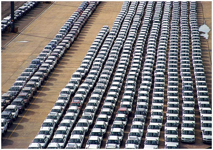 May 2nd 2005.<br /> <br /> Rozelle.<br /> <br /> The Conaust Car Terminal is where car shipments from overseas arrive in Sydney. As the cars are driven off the ship they are parked in long lines to await processing. <br /> <br /> EXIF DATA <br /> Canon 1D Mk II. EF 24-80 f/2.8L USM @80mm. 1/125s f/11. Shutter priority. ISO 200.
