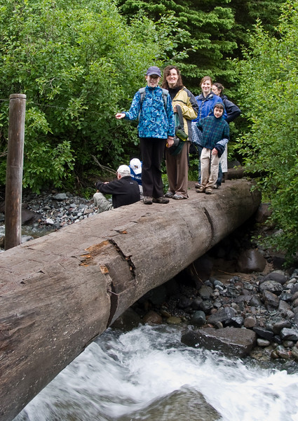 Crossing a log bridge.