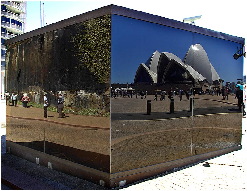 Bennelong Point, Saturday November 12th 2005. <br /> <br /> The security office at the entrance to the Opera House precinct has highly reflective glass walls. <br /> <br /> EXIF DATA <br /> Canon 1D Mk II. EF 17-35 f/2.8L@17mm 1/100s f/8 ISO 200.
