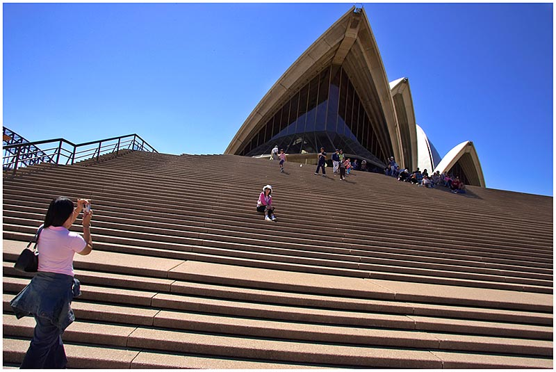 Sydney Opera House, Monday October 3rd 2005.   <br /> <br /> A popular spot to have a photo taken.<br /> <br /> EXIF DATA <br /> Canon 1D Mk II. EF 17-35 f/2.8L@17mm 1/100s f/18 ISO 200.