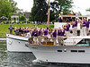 The UW marching band floats by.