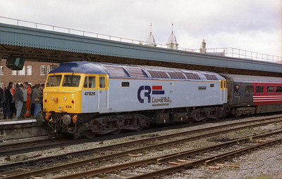With the ceremony to name the locomotive 'Joe Strummer' taking place in the background, Cotswold Rail's 47828 is pictured at Bristol Temple Meads having arrived in multiple with '316 on Pathfinder's 1Z56 1048 Wolverhampton-Newport charter (12/02/2005)