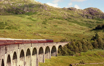 47854 crosses the spectacular Glenfinnan Viaduct with the returning 1Z22. It's a day that will live long in the memory, particularly the sight and sound of 47826 climbing to both Corrour and County March Summits later that evening (06/08/2005)