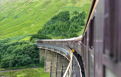 Journeying into the unknown, 47854 rounds the Horseshoe Curve on the approach to Bridge of Orchy with SRPS Railtours' 1Z20 0501 Dundee-Fort William charter (06/08/2005)