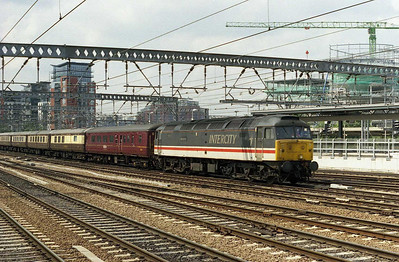 Dwarfed by the city's ever-changing skyline, 47826 'Springburn' approaches Leeds with 5Z62 1005 Carnforth-Tees Yard ecs. Due to exhaust problems, '826 was hurriedly returned to its home depot and exchanged for 47851, which worked the following day's Saltb