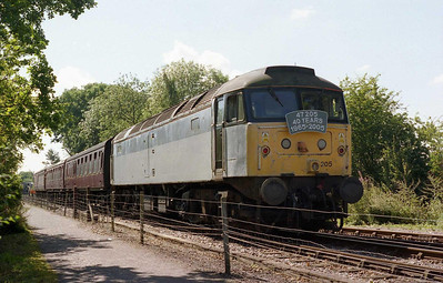 Having unfortunately failed barely 30 minutes into its first advertised running day since its preservation at the Northampton and Lamport Railway, 47205 stands 1/4 short of Pitsford & Brampton station awaiting recovery by the resident '45' (21/08/2005)