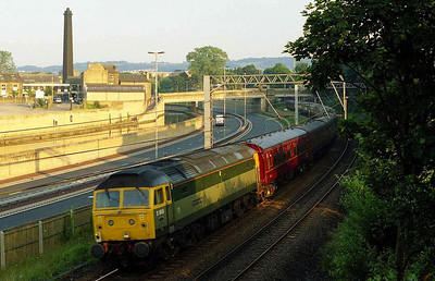 On the rear of 5Z60 was 47851, seen here catching the late evening sunlight as the train rounds the curve into Bingley station (08/07/2005)