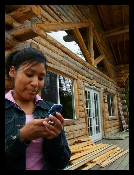 Frozen forever as she prepares for retaliation photos using her camera phone.