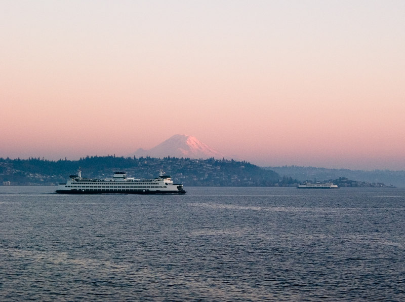 Ferries crossing under the mountain, in front of West Seattle.